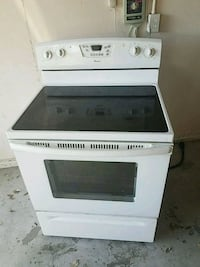 white and black induction range oven 788 mi