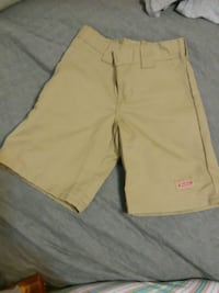 Dickies tan shorts with adjustable waist line.