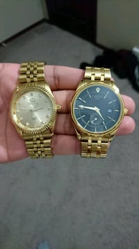 two round gold analog watches with link bracelets Calgary