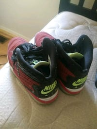 pair of black-and-green Nike running shoes Laurel Hill, 28351