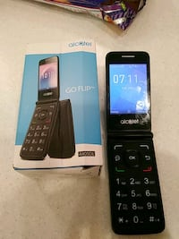Alcatel cell phone with box and charger 3153 km