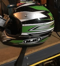 White, green, and black hjc motocross helmet Ontario, 91764