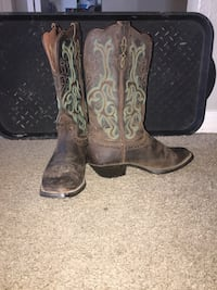 pair of brown cowboy booties