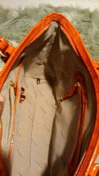 red and gray leather bag 956 mi