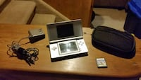 Nintendo DS Lite with charger, case and game.