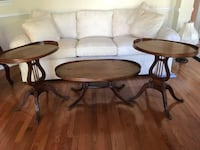 Three oblong brown wooden side tables