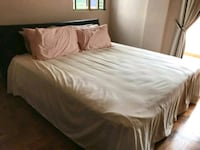 white bed sheet with brown wooden bed frame Singapore