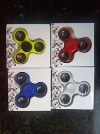 four assorted colored hand spinners in boxes Dale City, 22193