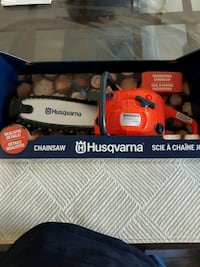 TOY HUSQVARNA CHAINSAW NEW IN BOX