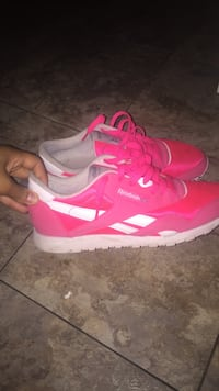 pair of pink-and-white Nike running shoes New York, 11224