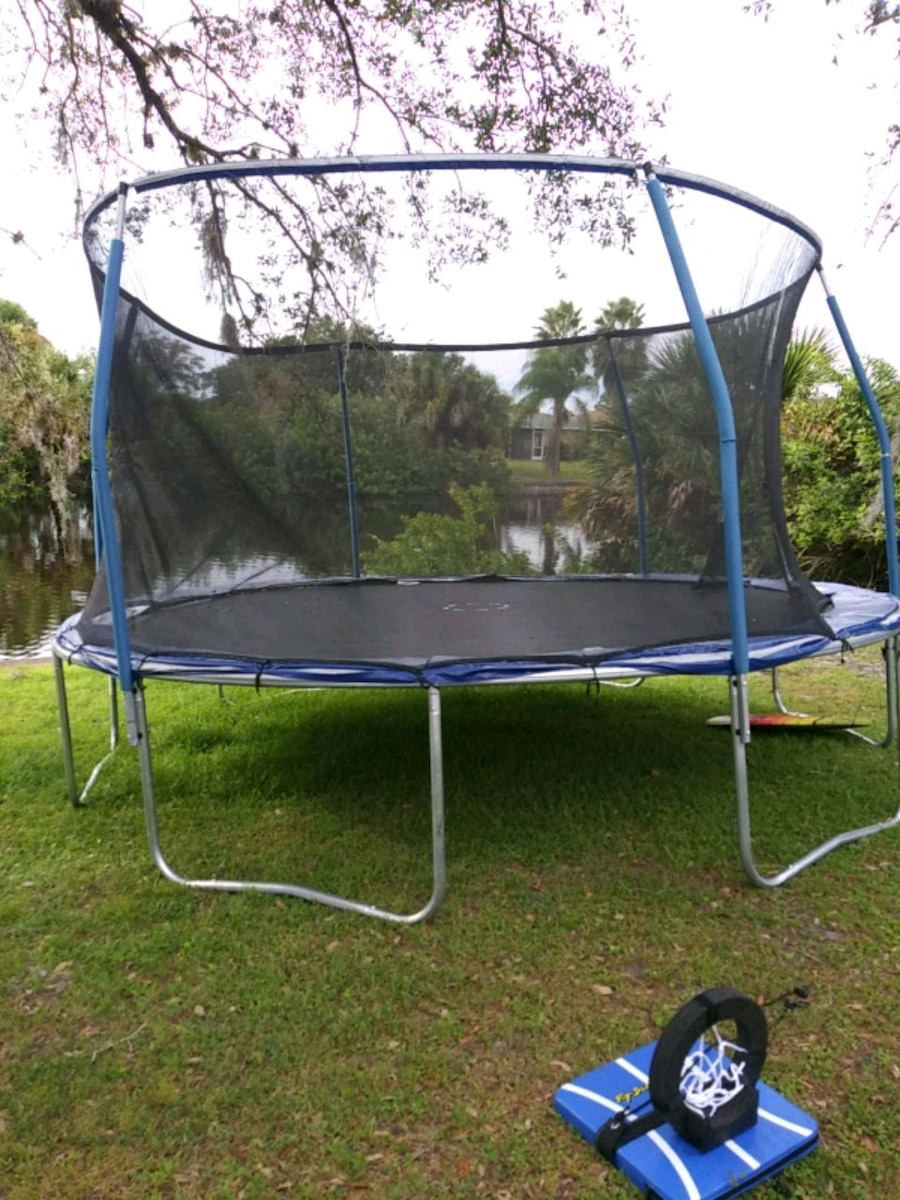 black and blue trampoline with enclosure, used for sale  Port Charlotte