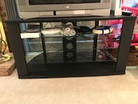 Glass and black tv stand. The shelves are removable for easier moving. Silver Spring, 20906