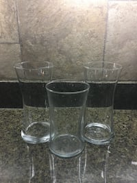 four clear glass vases