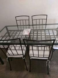 black metal framed glass top table with chairs Silver Spring, 20904