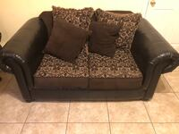 Brown and black floral loveseat Paterson, 07524
