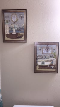 two brown wooden framed painting of people Laredo, 78045