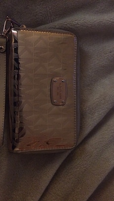 women's brown Michael Kors wallet