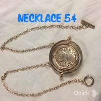 gold-colored chain with round pendant necklace Halifax, B3N 2C7