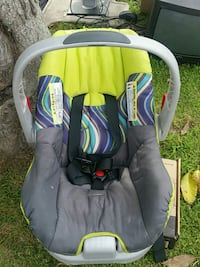 baby's gray and green car seat carrier
