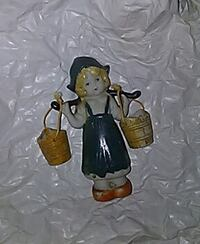child carrying two buckets ceramic figurine Crescent City
