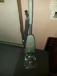 gray and black upright vacuum cleaner