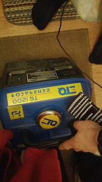 black and blue Ryobi power tool