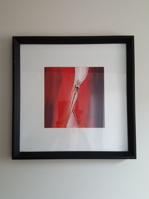 red and brown abstract painting with black wooden frame