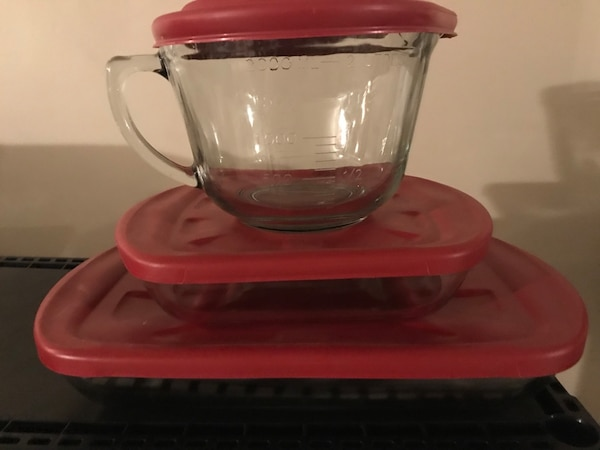 clear glass bowl with red lid