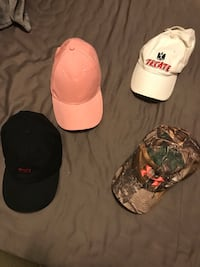 three assorted color fitted caps College Park