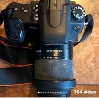 Sony a300 DSLR-A300 includes the following: 55mm Ultraviolet Lens, Bower Flash, Polaroid Flash,  Vello Wireless Remote, 4gb memory disc, 2 batteries with charger, all necessary wiring. Everything as seen in photos including case and user manual. Camera al Sayreville, 08872