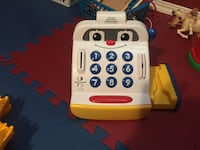 white and blue telephone toy