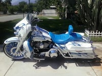 white and blue touring motorcycle Highland, 92346