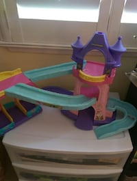 girl's purple, pink and blue plastic castle toy set