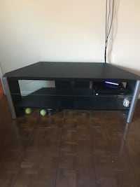 """black wooden framed TV stand 21"""" tall 53"""" long 15 1/2"""" deep. Good used condition. Bought new tv stand need gone   Carson, 90746"""