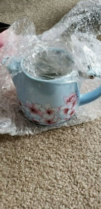blue and pink floral ceramic bowl