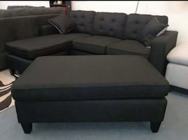 Brand new black linen sectional sofa with ottoman