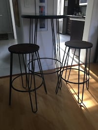 Bar height bistro table and 2 stools. Like new funky and modern