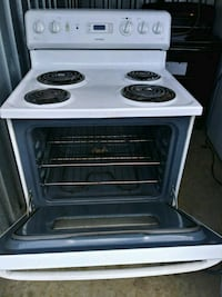 white and black electric coil range oven 48 km