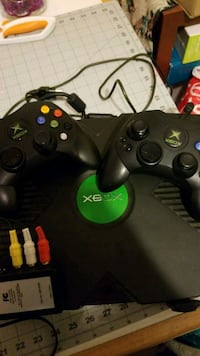 Xbox with 2 controller.   Kingston, 12401