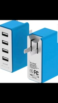 BRAND NEW 4 PORT USB CHARGER IN BOX
