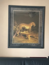 Framed painting of two leopards
