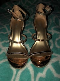 Pair of open toe ankle strap heels