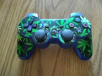 green and blue Sony PS3 controller