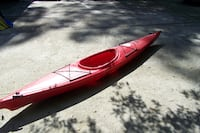 red and white kayak boat COLUMBIA