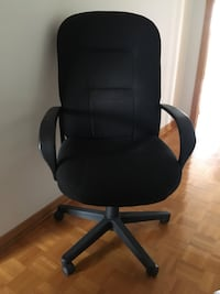 Black office rolling armchair Montreal, H1E 6E8