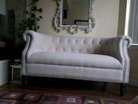 Brand new love seat and free cushions