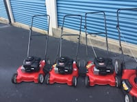 three red-and-black push mowers Lawrenceville, 30045