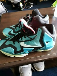 pair of black-and-teal Nike basketball shoes Cleveland, 44102