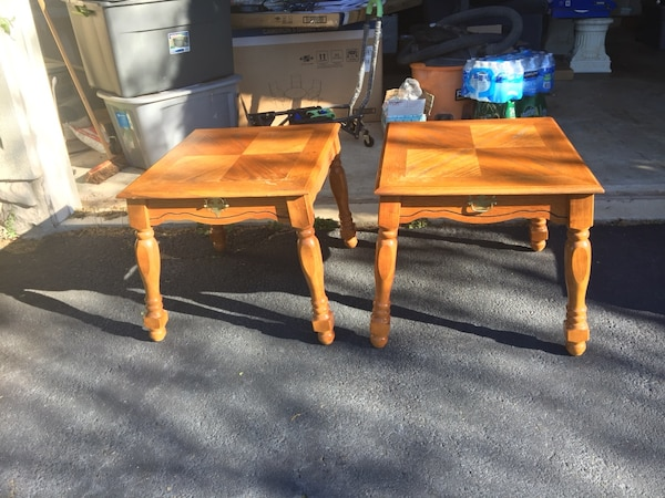 Three brown wooden tables
