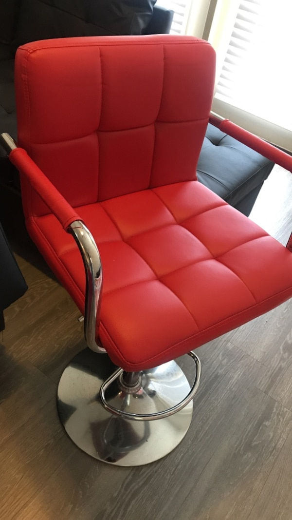 red leather padded rolling armchair 682036e8-969e-45ed-8915-05145c72dc6e